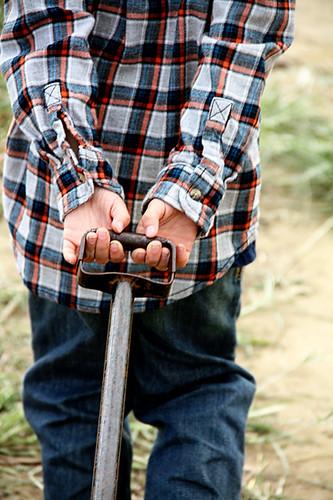 Nat-hands-pulling-wheel-barrow