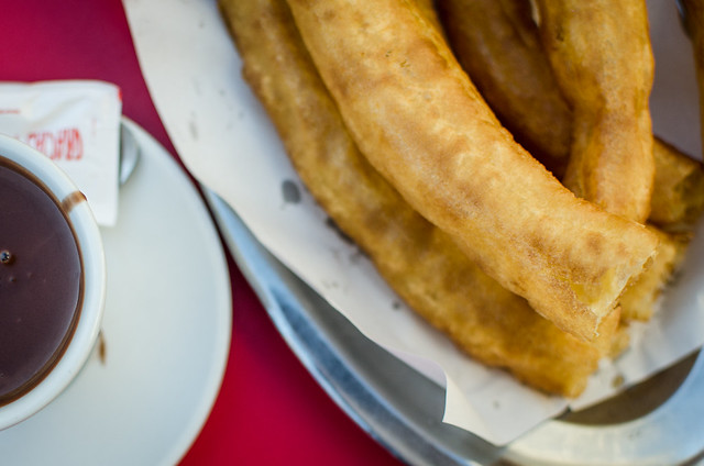 A platter of churros served with drinking chocolate in Sevilla, Spain.