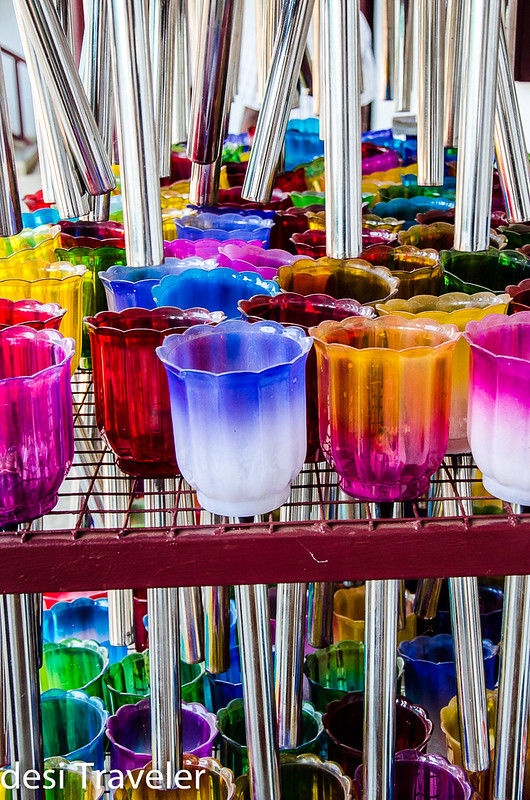colorful candle holders in church