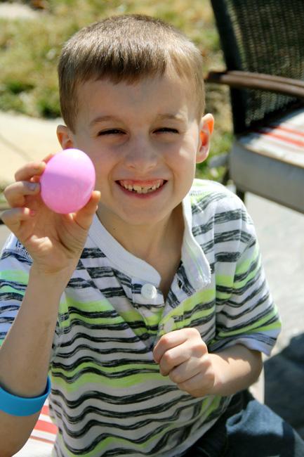 Nat-holding-up-pink-egg