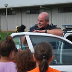 July 24, 2015 - 08:56 - Cpl Michael Swords visiting and showing off is patrol car to a group of kids from St. Jules Elementary