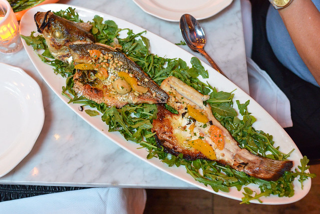 WOOD ROASTED STRIPED BASS served whole, citrus and pinenut gremolata
