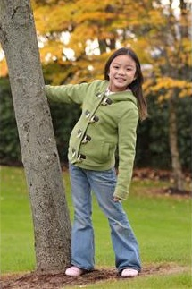 Little girl next to a tree