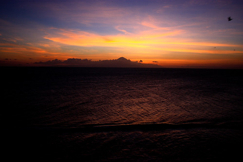 the final colors from sundown start to fade away… Bali's volcano in the distance