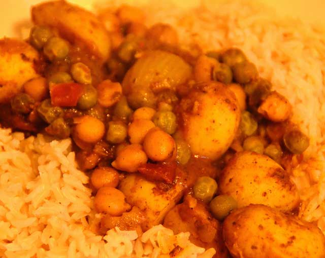 Vegetarian Curry Recipe with chickpeas and chopped potatoes on a bed of rice