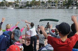 Coast Guard Sector St. Petersburg crew members and their friends and family cheer as the 2014 Gasparilla Parade and Pirate Festival passes by Sector St. Petersburg's Prevention Department, at Davis Islands, Fla., Saturday, Jan. 25, 2014. Coast Guard, Coast Guard Auxiliary and Florida Fish and Wildlife Conservation Commission officers teamed up with local law enforcement agencies to keep waterways safe during the event. (U.S. Coast Guard photo by  Seaman Meredith Manning)