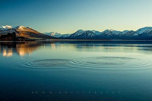 blue newzealand sun snow mountains reflection nature canon landscape scenery view mr ngc peaceful canterbury symmetry serene ripples mirrorimage picturesque naturesbeauty southislandnz lakeheron fabphotography fernandezbarrett