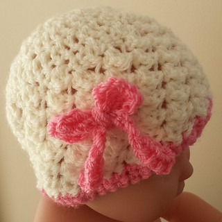 Newborn cream and pink cloche with bow detail