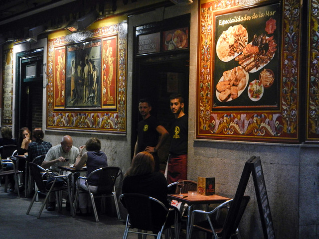 In Madrid, a Street with Cafes with Tiled Murals