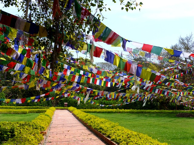 Colourful Flags, Lumbini by CC user anandajoti on Flickr