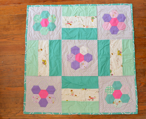 baby girl quilt with english paper piecing and posey fabric