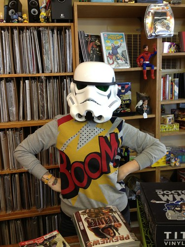 Kate wearing a storm trooper helmet in a comic store