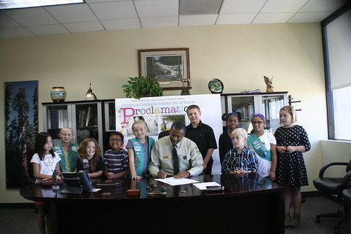 Children gather around Regional Forester Randy Moore's desk as he signed a proclamation endorsing the California Children's Outdoor Bill of Rights. The Pacific Southwest Region supports the Children's Bill of Rights, which encourages children to experience outdoor activities. (U.S. Forest Service/Mario Chocooj)
