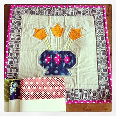 My #dudqs package arrived! This gorgeous mini was made by Rebecca, who isn't on ig. Paper-pieced pattern by @stitchedincolor And three Bonnie + Camille FQs!