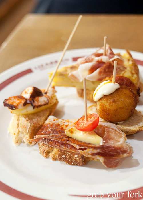 Octopus, jamon and croquetas pintxos at Lizarran, L'eixample, Barcelona