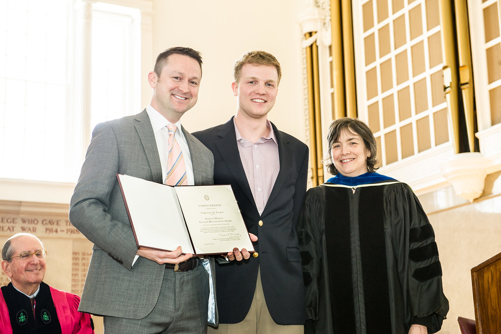 Gideon Hawley Award recipient Christian Talbot (left) accepts his award with Jakub Kaczmarzyk '16 and Therese McCarty, vice president of Academic Affairs.