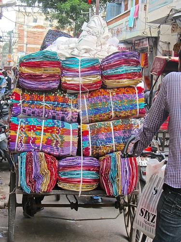 a cart full of colorful fabrics
