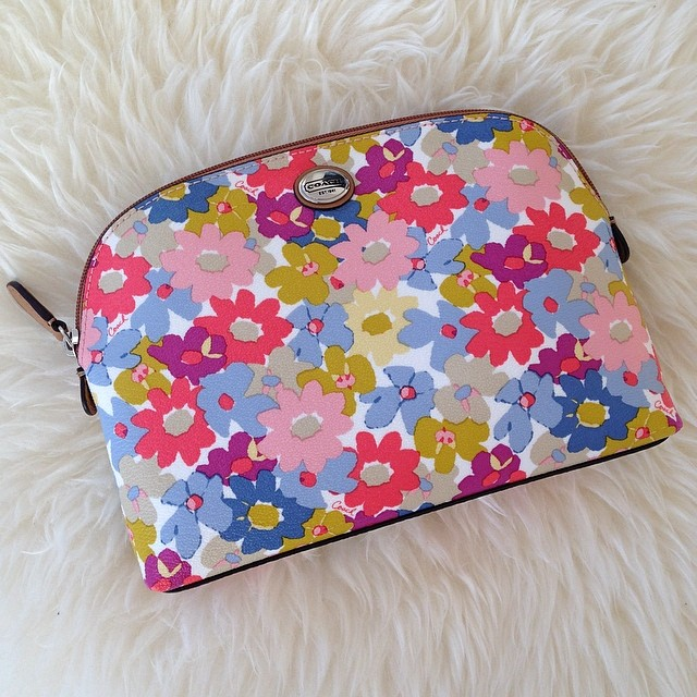 I've got #spring in my bag. Loving the floral print on this #makeupbag. :)