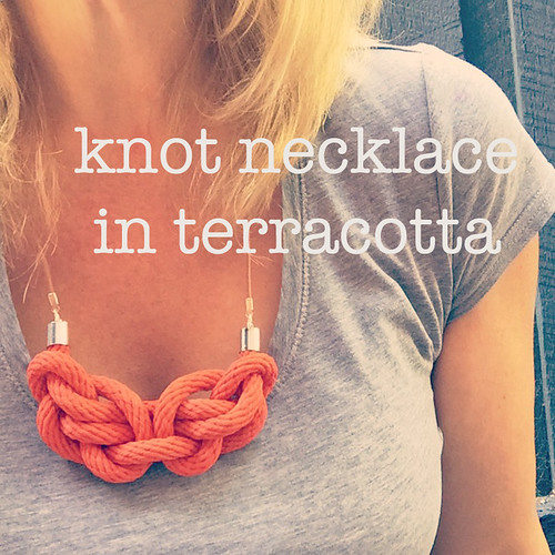 Knot necklace (worn) with text