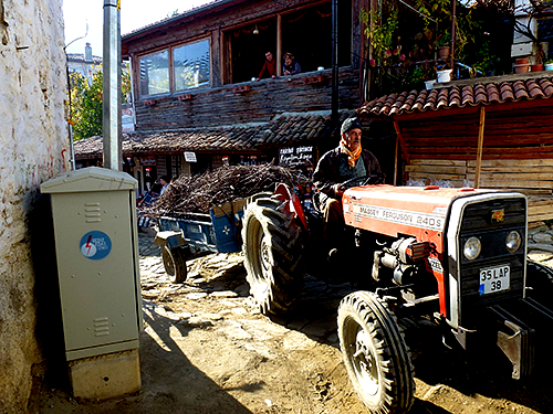 Turkish country scenes often include farm tractors pulling produce, firewood or fam implements through the local villages, all in a friendly wave and a smile and a wave to passing tourists and travellers.