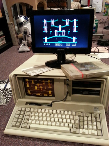 Dual displaying Lode Runner on an IBM Portable Personal Computer.