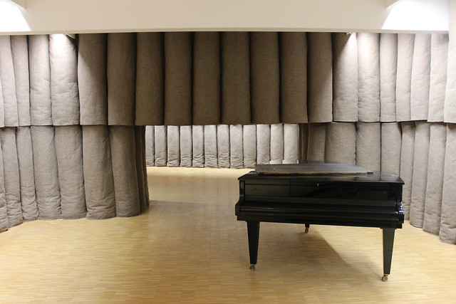 Insulated room with unplayed piano