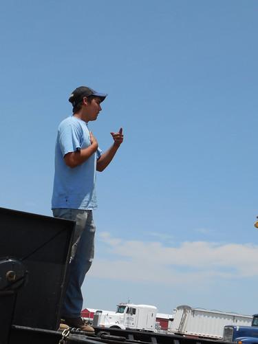 Jose directs Brandon as he loads the combine