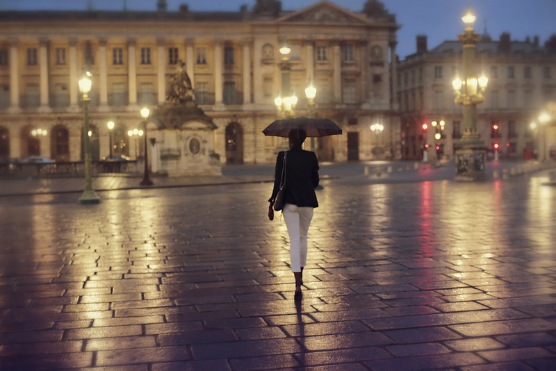 Woman Walking in Place de la Concorde in the Rain