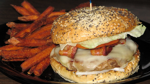 Bacon Swiss turkey burger and seasoned sweet potato fries by Coyoty