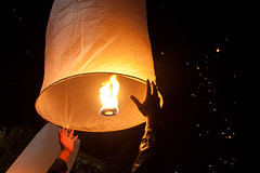 Releasing a sky lantern, NYE, Chiang Mai