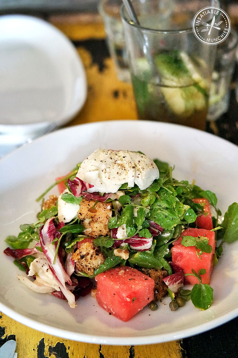 rose-infused watermelon salad with watercress, mozzarella and capers.