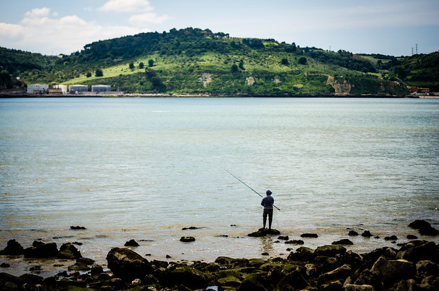 Locals fish from the River Tagus at the base of Torre de Belém in Lisbon.