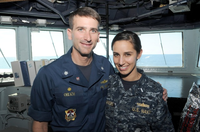 Cdr. Justin Orlich, CO of USS Chung-Hoon visits with his neice Lt. j.g. Laurel Fernandes who is assigned to USS Blue Ridge