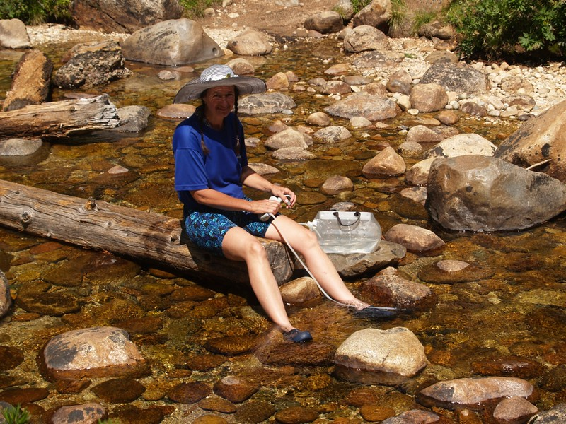 Vicki filtering water from Spiller Creek as we prepare to ascend the PCT toward Miller Lake