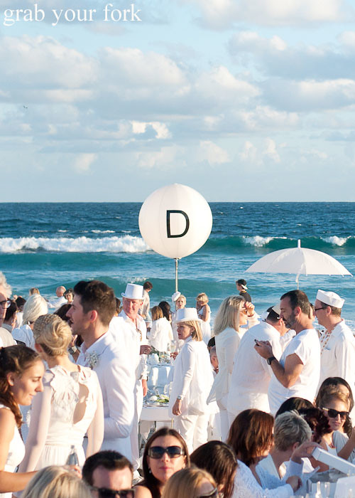 White top hats and umbrellas at Diner en Blanc Sydney 2013 Bondi Beach