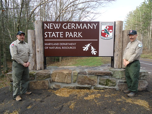 Park Technicians Sean Rafter (left) and Mark Beals stand beside the new sign.