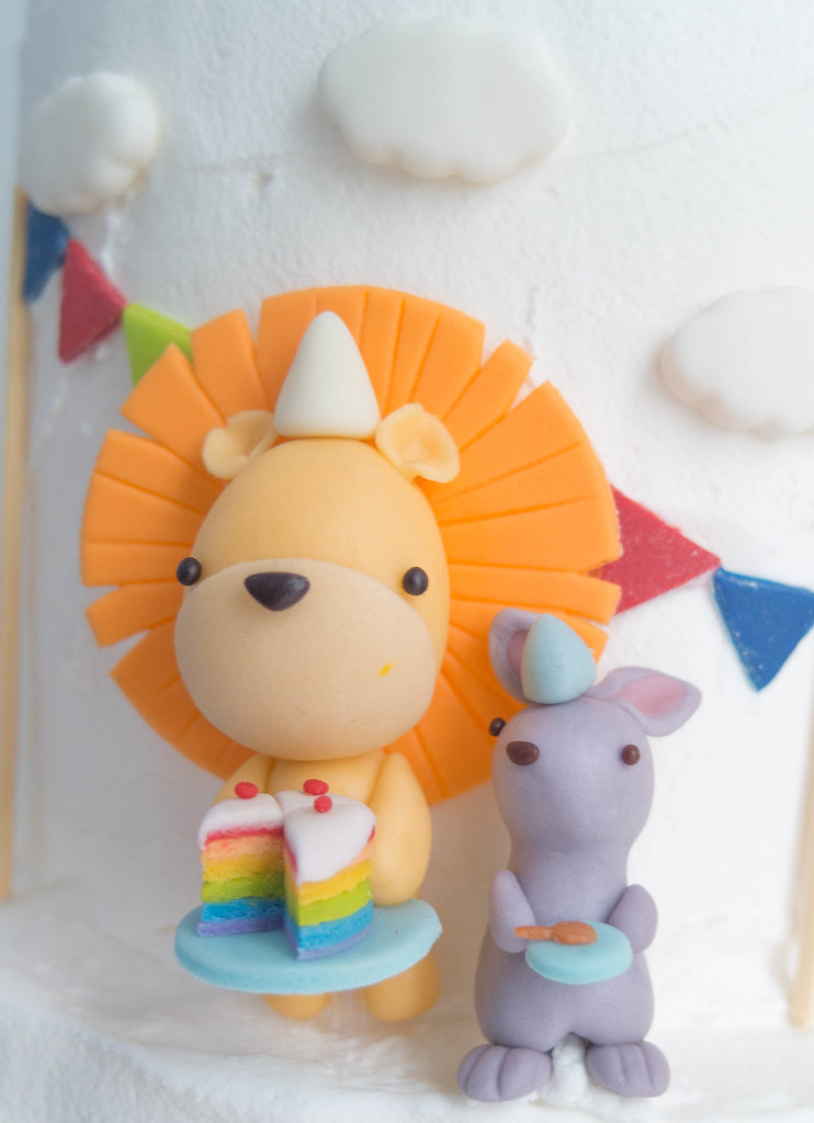 Lion sharing his rainbow cake with the bunny!