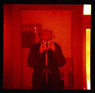 reflected self-portrait with Coronet Rapier II camera and grey hat
