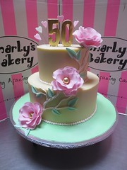 2 Tier Wicked Chocolate 50th Birthday Cake Iced In White Ganache Decorated With