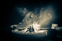 Campfire and sparks - split-toned long exposure grainy