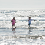 Abbie and Jack frolicking in the waves