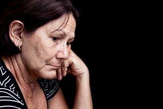Sad and worried midlife woman