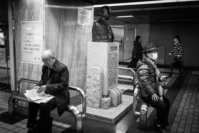 Three heads. Ginza station, Tokyo.