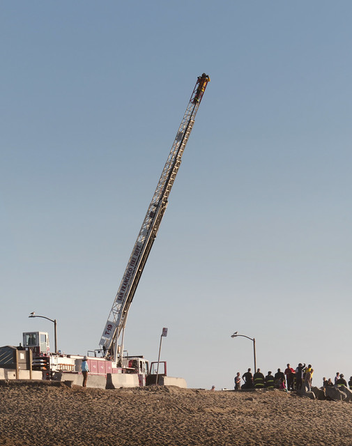Fireman with binoculars on ladder at Ocean Beach, San Francisco; January 20, 2015