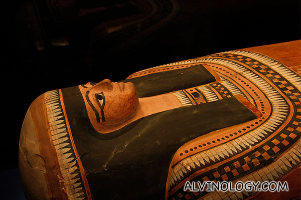 Close-up of the face on the coffin