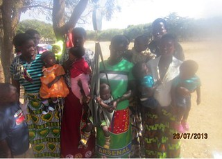 Picture 7 - Mothers weighing Child