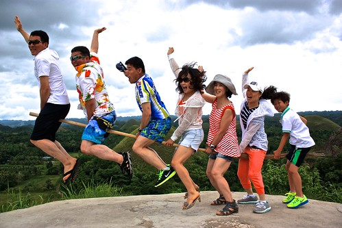Asian tourists try their hand at a jumping shot