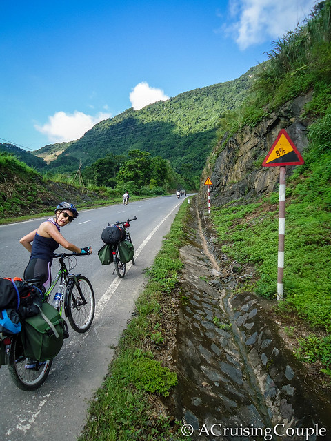 A Cruising Couple Cycling Uphill