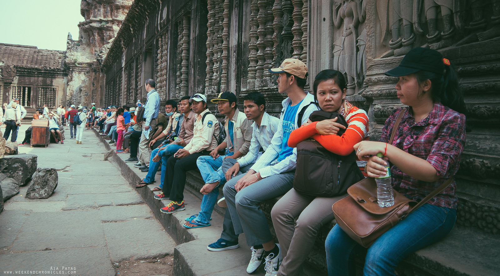 Tourists resting after a long walk to the inner part of Angkor Wat