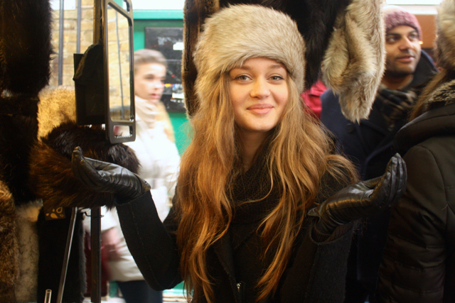 Trying on fur hats at the Greenwich Market, Greenwich